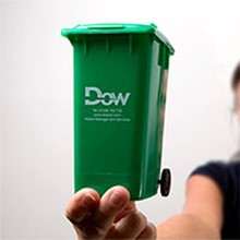 Wheelie bin hire in Glasgow mini bin held by Sheila Dow.
